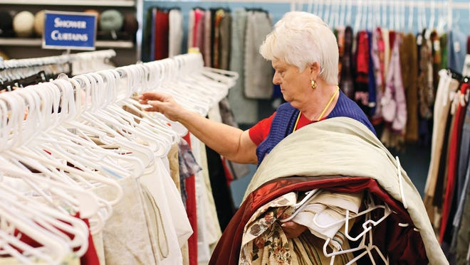 Betty Sadler organizes clothes at Goodwill in Hendersonville.