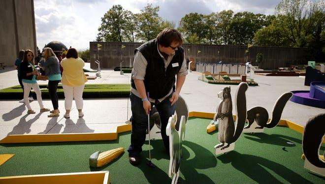 Jason Hamman putts on the Mini Golf at the IMA course on May 5, 2016.
