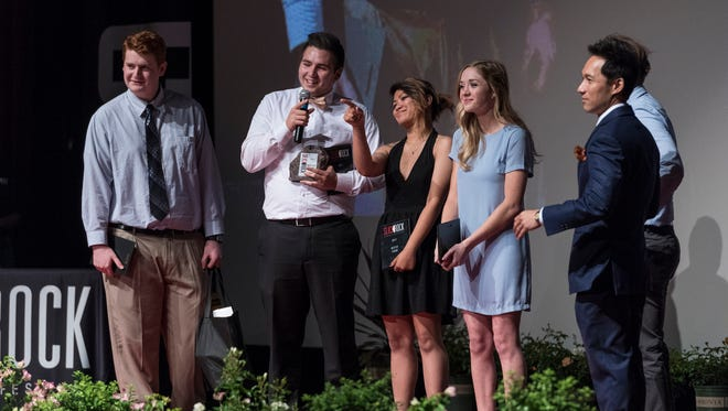 """Buchanan High School students receive the Festival Best of Show Award for their original music video """"Anywhere"""" during the 2017 Slick Rock Awards Ceremony at the Fox Theatre on Friday, May 12, 2017. More than 650 films were entered in 18 categories this year by middle school and high school students throughout the Central San Joaquin Valley. Ham received the award last year."""