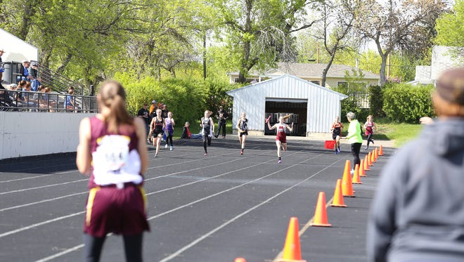 Athletes compete at the Northern C Divisional Track Meet at Memorial Stadium, May 18, 2017.