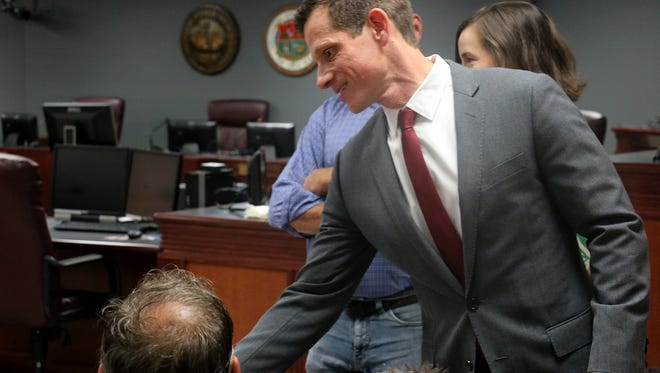 U.S. Senate Democratic candidate James Mackler shakes hands and passes out business cards at the monthly Williamson County Democratic Party meeting at the Williamson County Administrative Complex.