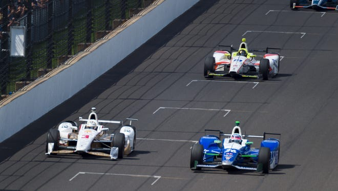 Andretti Autosport IndyCar driver Takuma Sato (26) maintains the lead over Team Penske IndyCar driver Helio Castroneves (3) heading into the final laps of the running of the 101st Indianapolis 500, at Indianapolis Motor Speedway, Sunday, May 28, 2017.