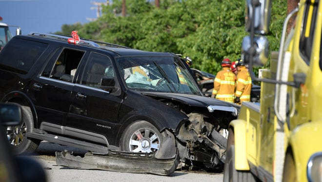 Tulare County Sheriff deputies, CHP officers and firefighters investigate a head-on collision on Avenue 328 about 1/4-mile west of Road 132 a on Monday, May 15, 2017. The impact killed one person and injured at least three more.
