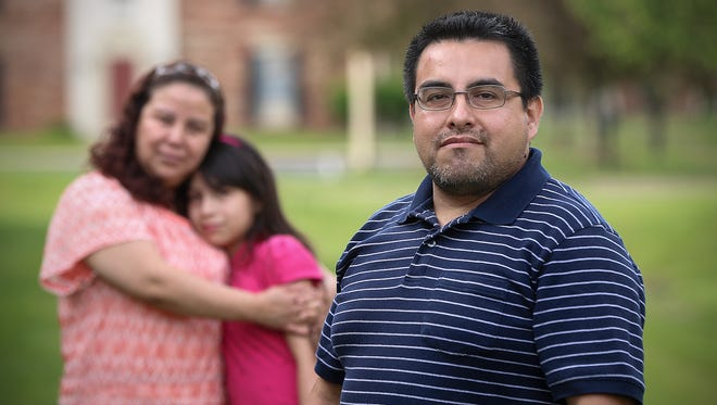 From left, Maria Ibrra, Citalaly Sanchez, 10, and Eduardo Sanchez, pose together outside their far east side home, Indianapolis, Tuesday, May 23, 2017. Eduardo was taken into U.S. Immigration and Customs Enforcement detention for a traffic violation several years ago, and now fears he and his wife could be deported.
