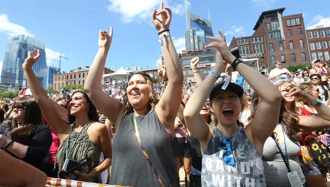 (L to R) Gina Jaimez, Crissa Poindexter and Brittney Rodgers cheer as Old Dominion takes the Riverfront Stage on the first day of CMA Fest 2017, on Thursday, June 8, 2017, in Nashville.