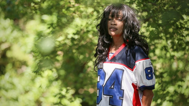 Jeanie Summerville wears her son James Hardy's Buffalo Bills number 84 jersey at Foster Park in Fort Wayne, Ind., Monday, June 12, 2017. The former Indiana University standout wide receiver and second-round NFL draft pick was found dead in Fort Wayne's Maumee River on June 7, 2017.