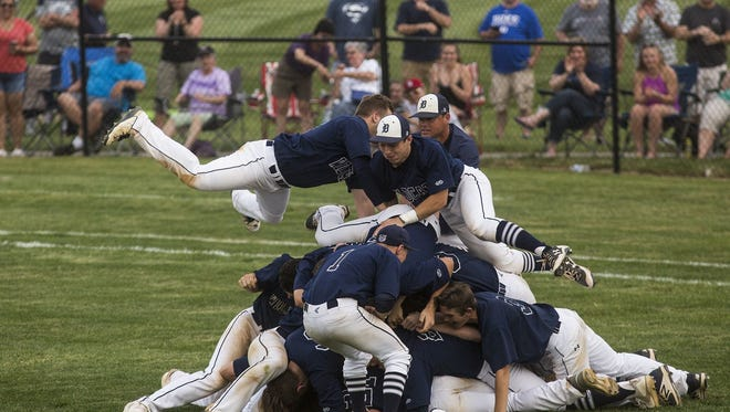 Dallastown celebrates after the final out. Dallastown defeated Gettysburg 2-0 in the YAIAA baseball championship.