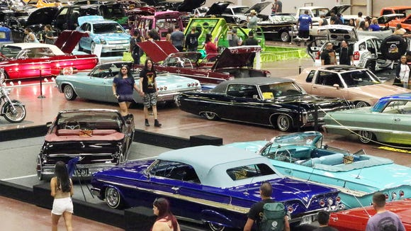 Classic cars, lowriders and motorcycles fill the El Paso convention center Grand Hall during the El Paso Downtown Street Fest. The Border Classic: An All-Car Showdown will take lowriders to the El Paso County Coliseum on Sunday.