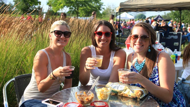 Katie Fahey-Salow, 26, Becky Domeyer, 26, and Amanda Stecker, 27. Katie Fahey-Salow, 26, Becky Domeyer, 26, and Amanda Stecker, 27, at Jasper Winery Summer Concert Series on Thursday, July 17, 2014.