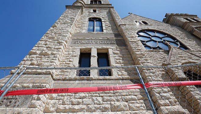 Fence and caution tape surround the entrance to St. Mary Church at the corner of Marquette Street and East Merrill Avenue in Fond du Lac Tuesday June 27, 2017 after pieces of the building reportedly fell to the ground. Doug Raflik/USA TODAY NETWORK-Wisconsin