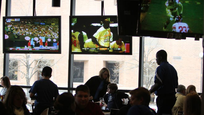 Televisions surround the Indianapolis Colts Grille, Friday, January 27, 2012.