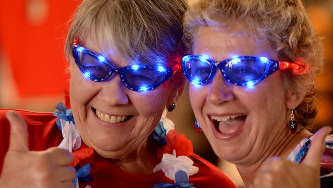 Revs employee Debbie Pflaum, left, and Barbara Kroner, of Shrewsbury, pose with their light-up glasses during Fourth of July at PeoplesBank Park, Tuesday July 4, 2017.  John A. Pavoncello photo