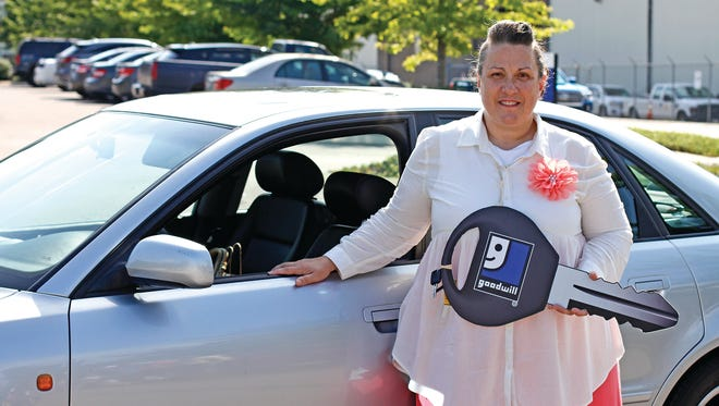 Christine McCrury, a six-year Goodwill employee in Lexington, received a donated car Thursday during a ceremony at Goodwill headquarters in Nashville.