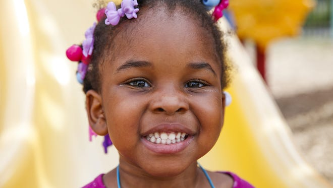 Leilah, 4, daughter of Adrienne Brown, loves the playground at Wheeler Mission Center for Women & Children.