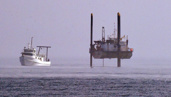 A large off shore drilling rig and survey boat off of Rehoboth Beach in the Atlantic Ocean in 2016.