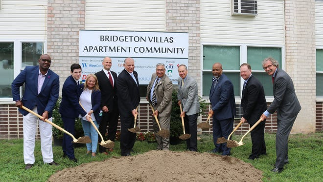 Dignitaries gather at a ceremonial groundbreaking for the Bridgeton Villas Apartment Community on Thursday.