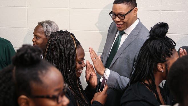 Indianapolis Public Schools superintendent Lewis Ferebee and members and volunteers from 100 Black Men of Indianapolis hold a high five rally, surprising students as they enter for the first day back to school at Crispus Attucks High School, Indianapolis, Monday, July 31, 2017.