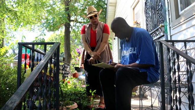Alderman At-Large Pearl Bransford goes door to door July 29, 2017, asking if property owners would want a historic overlay in their neighborhood.