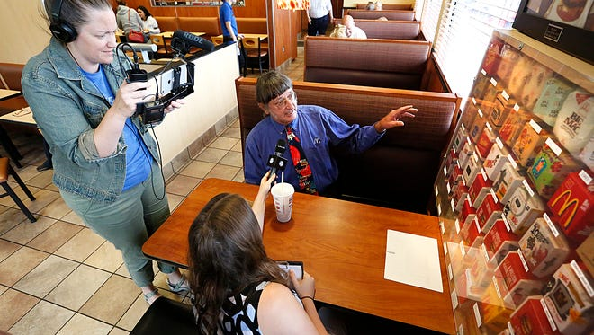 Claire Stephens and Claire Mc Clanahan of Guinness Book of World Records do a Facebook Live feed with world record Big Mac eater Don Gorske Friday at the Mc Donalds on Military Road in Fond du Lac.