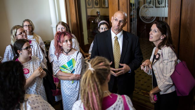 Rick DeLeon, Sergeant At Arms for Texas Senate, tells Planned Parenthood supporters that they are not allowed to enter the secure back hallway of the Senate while they are in session at the State Capitol on Wednesday, July 26, 2017 in Austin.