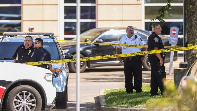 The scene outside IU Health Methodist emergency entrance after a possible robbery suspect's vehicle struck a Southport police officer, Wednesday, August 9, 2017. The officer an injury but was in stable condition as of Wednesday afternoon.