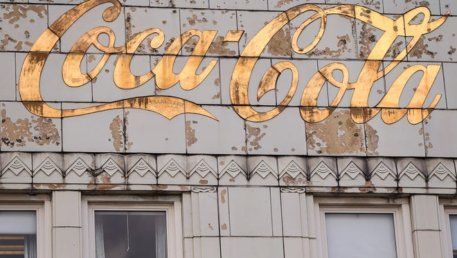A worn Coca-Cola logo, as seen during a media tour of the Coca-Cola bottling plant on Massachusetts Avenue, Indianapolis, Saturday, August 12, 2017. The historic Art Deco campus will be re-constructed into a bustling, mixed-use district in coming years, including the main building's transformation into a hotel.