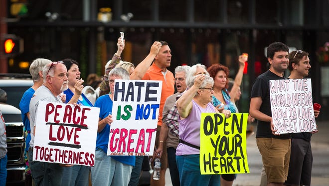 "Dozens gathered in downtown Hanover for the ""Hate Has No Home In Hanover"" peace vigil on Sunday, August 13, 2017 in the Hanover square. The vigil was held in solidarity of the victims of the Charlottesville protests and stood against hate."