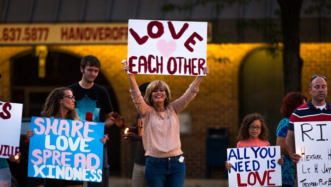 """Dozens gathered in downtown Hanover for the """"Hate Has No Home In Hanover"""" peace vigil on Sunday, August 13, 2017 in the Hanover square. The vigil was held in solidarity of the victims of the Charlottesville protests and stood against hate."""