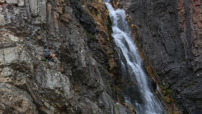 A teenager climbs the cliffs near Apikuni Falls in Glacier National Park. When exploring the park, make sure you know your abilities. Falling and drowning are the leading causes of death in Glacier. Bookmark and Share  Bookmark and Share