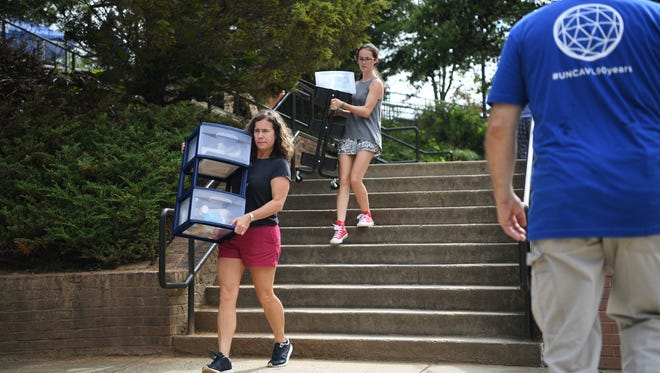 Freshman were welcomed and moved into their dorms with help from staff and faculty at UNC Asheville August 18, 2017
