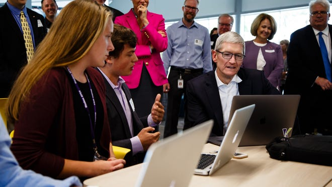 Apple CEO Tim Cook talks with Waukee Apex alum Jacob Rousch during a tour of the center on Thursday, Aug. 24, 2017 in Waukee.