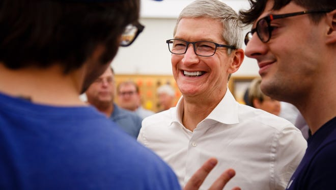 Apple CEO Tim Cook talks with employees on a visit to the West Des Moines Apple Store on Thursday, Aug. 24, 2017. Cook was in Iowa announcing the companies plans for its $1.375 billion data center in Waukee.