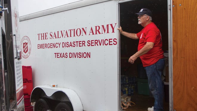 Bruce Peterson, of Austin, stands inside a cargo trailer containing relief supplies brought by The Salvation Army to Seadrift, Texas to help provide aid to those in community Monday, Aug. 28, 2017.  (The Victoria Advocate via AP)