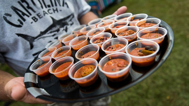 Mike Camplese, of Wellsville, Pa., holds up a tray of Hellbelly red chili during the annual Hanover Chili Cook Off at Good Field on Sunday, Sept. 3, 2017 in Hanover.