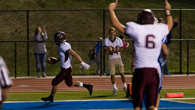 Mechanicsburg's Joseph Bruno (7) scores a touchdown after making a run during the first half of a game between Mechanicsburg and Spring Grove on Friday, Sept. 8, 2017 at Spring Grove High School.