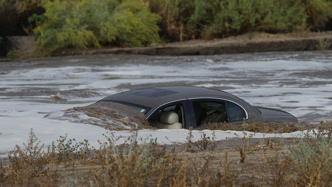 This vehicle was swept by water at the wash on Golf Club Drive after the driver made an attempt to cross fast rising water from an intense rain on September 9, 2017.