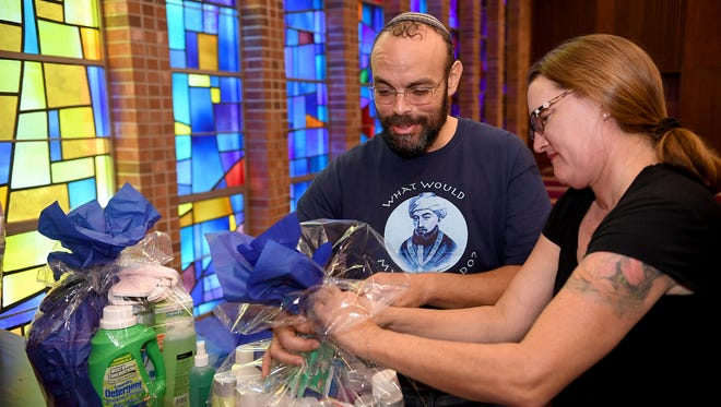 Congregation Beth Israel's Rabbi Mathew Marko and his wife Marie decorate the sanctuary with toiletries during its 2016 Dignity Drive. The synagogue is again collecting toiletries through the Jewish High Holidays to benefit Harvest Hope Food Bank.