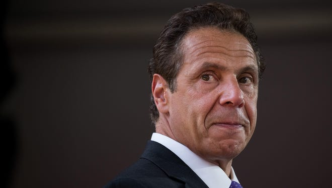 New York Gov. Andrew Cuomo issued an executive order Friday, Sept. 15, 2017, that bans state agencies and State Police from asking about or disclosing an individual's immigration status in most cases. Here, the governor is at a dedication ceremony to mark the opening of the new campus of Cornell Tech on Roosevelt Island on Wednesday, Sept. 13, 2017, in New York City.