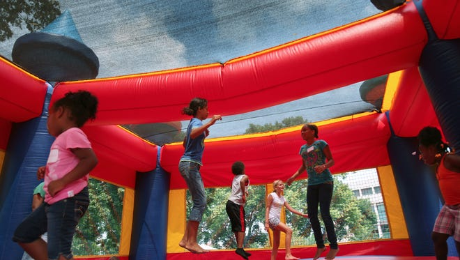 2011 file photo of kids playing in a bounce house.