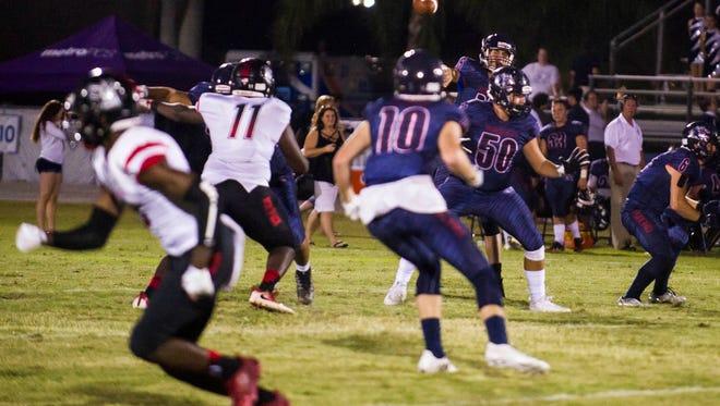Estero High School quarterback Tanner Elliott throws against South Fort Myers High School at Estero High School on Friday, September 22, 2017.