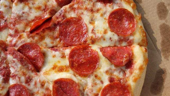 """Lawsuits filed against Little Caesars alleged it served pork that was sold as """"halal pepperoni."""" A judge tossed out one lawsuit against the pizza chain Thursday, Sept. 21, 2017, but allowed another to move forward. Here, pepperoni pizza from Little Caesars."""