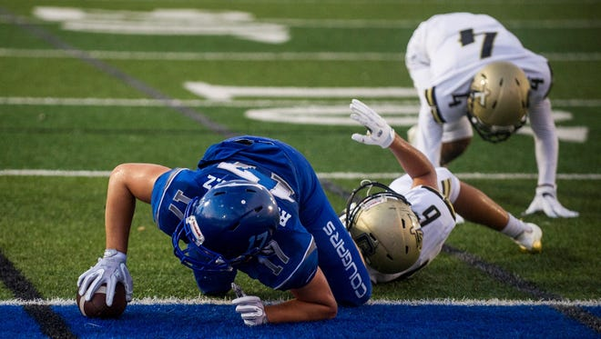 Barron Collier High School wide receiver Logan Rodriguez reaches for the end zone to score the game's first touchdown against Golden Gate High School at Barron Collier on Thursday, September 28, 2017.