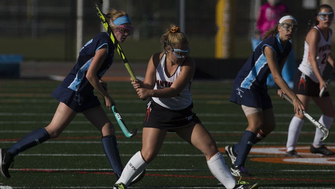 Central York's Kaitlyn Merritt prepares to strike the ball. Central York defeats Dallastown 3-1 in field hockey at Central York High School, Monday, October 2, 2017.