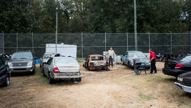 October 12, 2017 - Major Barry Thompson, Panola County SheriffÕs Department, center, stands near the remains of Jessica Chambers car in an impound lot behind the Panola County Sheriff's Department on day 3 of the trial of Quinton Tellis. Tellis is charged with burning 19-year-old Jessica Chambers to death almost three years ago on Dec. 6, 2014. Tellis has pleaded not guilty to the murder.