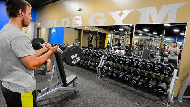 Zach Nelson of York works on his biceps with a curl bar at the newest Gold's Gym location, in the York Galleria, Thursday, Oct. 12, 2017. John A. Pavoncello photo