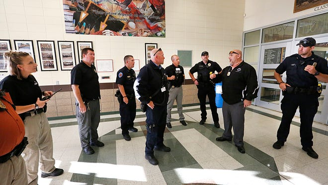 Waupun Police Officer and school liaison officer Jason Hraban (second from right) instructs other officers how they are going to search and evacuate students Thursday October 5, from the Waupun High School during a lockdown/evacuation drill that involved a simulated shooting. Doug Raflik/USA TODAY NETWORK-Wisconsin