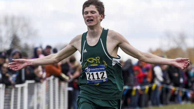 C.M. Russell's Cooper West finishes first in the AA boys' race during the State Cross Country meet in Helena Saturday.