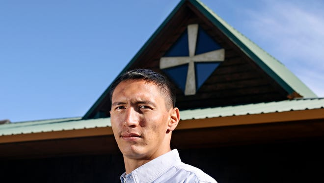 In this Oct. 5, 2017 photo, Jesse DesRosier, Blackfoot language instructor at Cuts Wood School poses in Browning, Mont. DesRosier's 28-year journey is a dizzying endeavor, even if he's right back where he started - living on the Blackfeet Indian Reservation, a community that at once seems tucked away and exposed, situated on an ecological nexus where rolling, wind-whipped foothills meet the jagged expanse of the Rocky Mountain Front and the birthplace of the Blackfeet creation story.  (Greg Lindstrom /Flathead Beacon via AP)