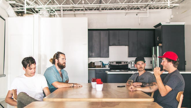 (Right to Left) Ryan Schemmel of Fort Houston, Nate Akey and Jeff Estes of of 5 String Furniture and Josh Cooper of Fort Houston reminiscing about their previous business relationship.