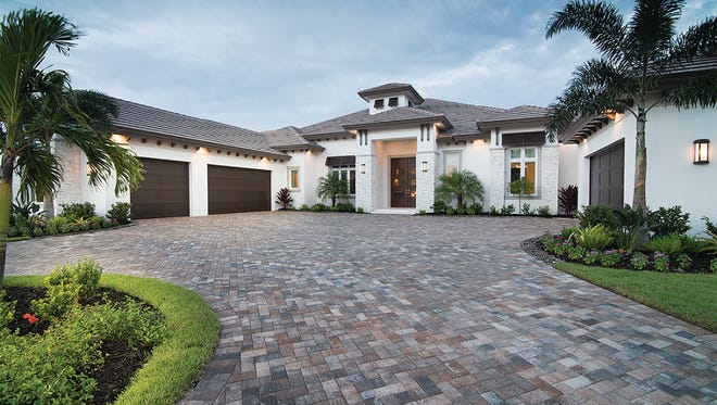 The La Mora model at Miromar Lakes Beach & Golf Club has 4,252 square feet under air and 6,023 total square feet. It was built by DIVCO Custom Homes.